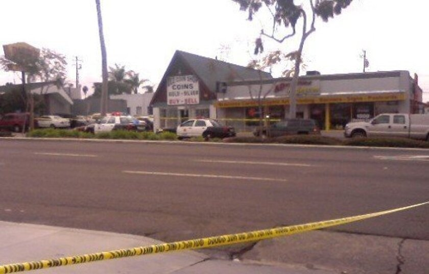 El Cajon Boulevard was closed in both directions after the robbery attempt at Old Coin Shop.