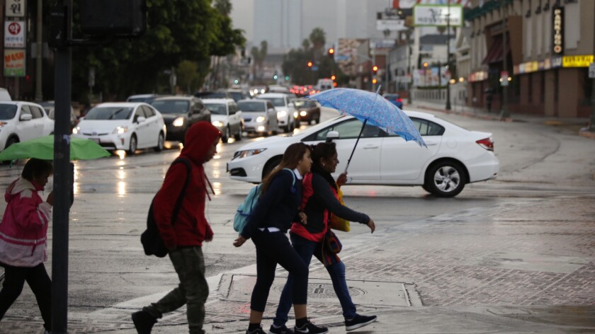 Rain dampened the Southland on Monday morning at Vermont and Olympic near downtown Los Angeles.
