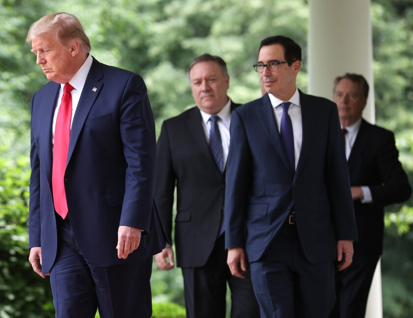 President Trump, left, Michael R. Pompeo, Steven T. Mnuchin and Robert Lighthizer walk to the White House Rose Garden May 29.