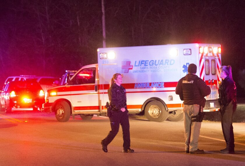 An ambulance leaves the scene with a wounded Brittany Harper after a shootout in the Florida Panhandle early Friday, Feb.5, 2016 in Milton, Florida. A weeklong search for a Missouri couple wanted in a series of robberies and abductions across the South ended with one suspect dead and the other wounded Friday, after authorities say they chased the pair across the highway and through a rural neighborhood and exchanged gunfire with them in Florida's Panhandle.