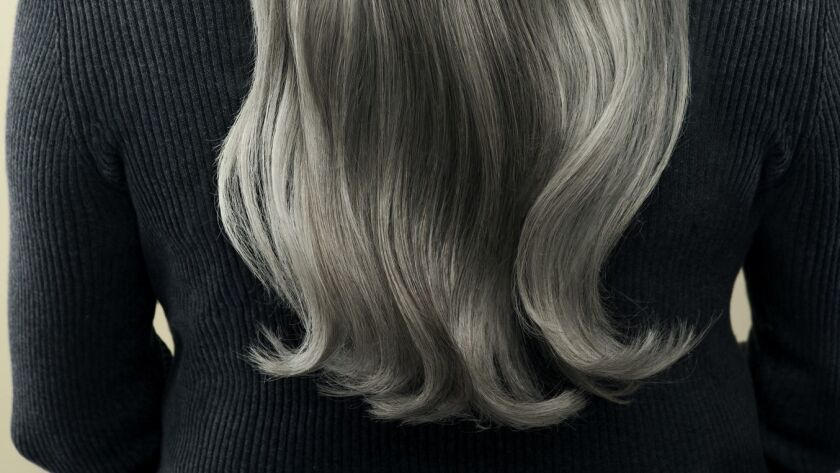 Mature woman with long, gray hair from her back. ** OUTS - ELSENT, FPG, CM - OUTS * NM, PH, VA if so