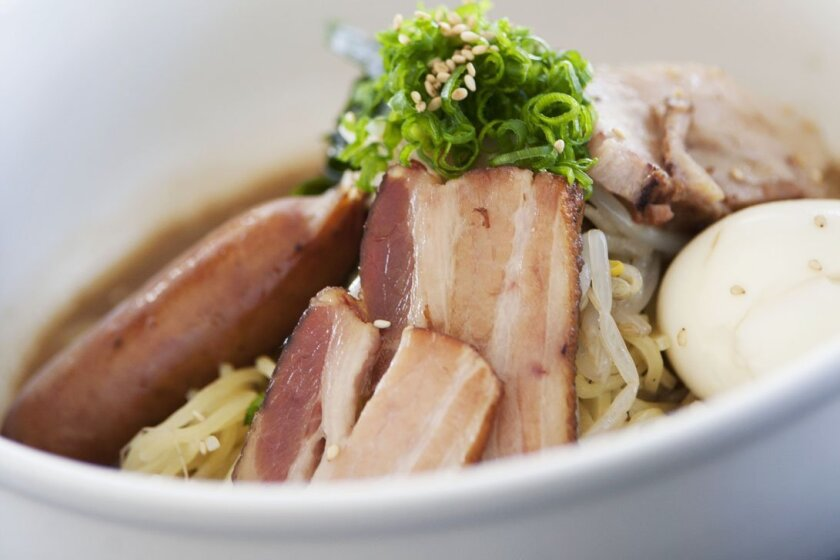 The Underbelly Ramen, with soft-boiled egg, char-siu belly, applewood smoked bacon and kurobuta sausage, can be found at Underbelly in Little Italy.