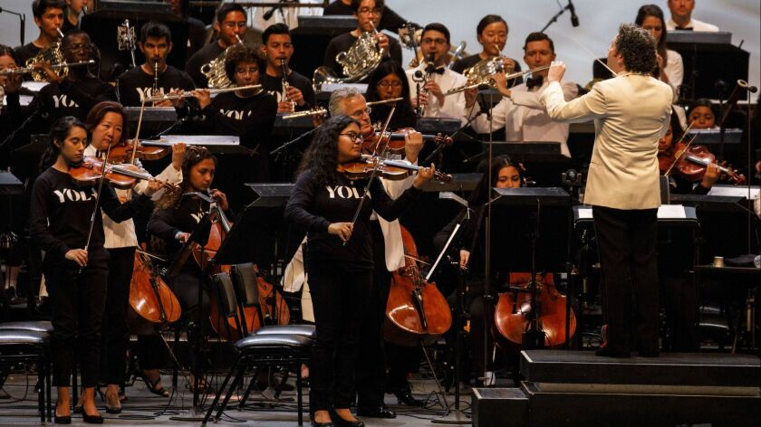 Gustavo Dudamel conducts the Youth Orchestra Los Angeles during the Los Angeles Philharmonic's 100th anniversary concert at the Hollywood Bowl on Sept. 30, 2018.
