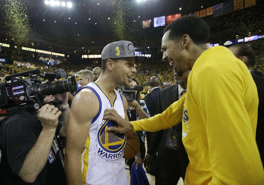 Golden State Warriors guard Stephen Curry, left, and guard Shaun Livingston celebrate after the Warriors beat the Oklahoma City Thunder in Game 7 of the NBA basketball Western Conference finals in Oakland, Calif., Monday, May 30, 2016. The Warriors won 96-88. (AP Photo/Marcio Jose Sanchez)