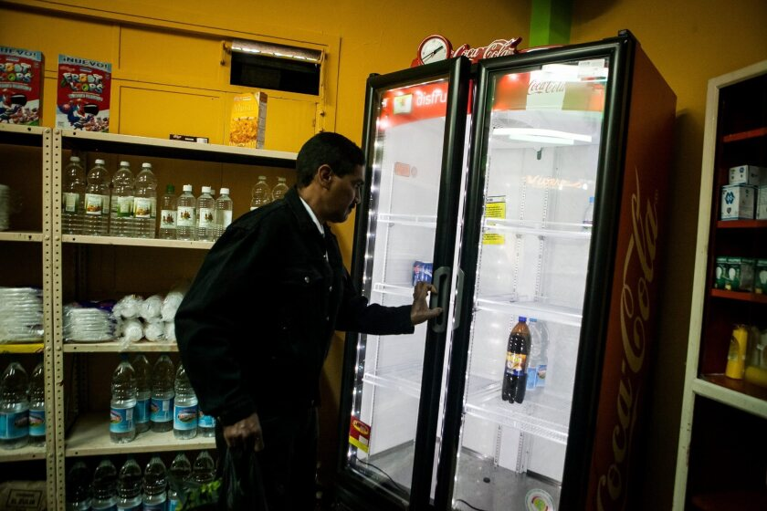 A refrigerator sits nearly empty in a shop in Caracas, Venezuela. Scarcities are one of many urgent problems facing Venezuela, which has offered asylum to Edward Snowden.