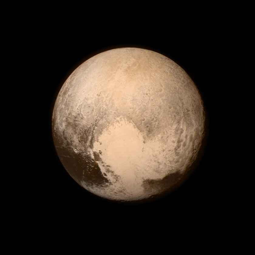"Pluto's ""heart"" is shown in an image from NASA's New Horizons spacecraft, taken on July 13 when the spacecraft was 476,000 miles from the surface."