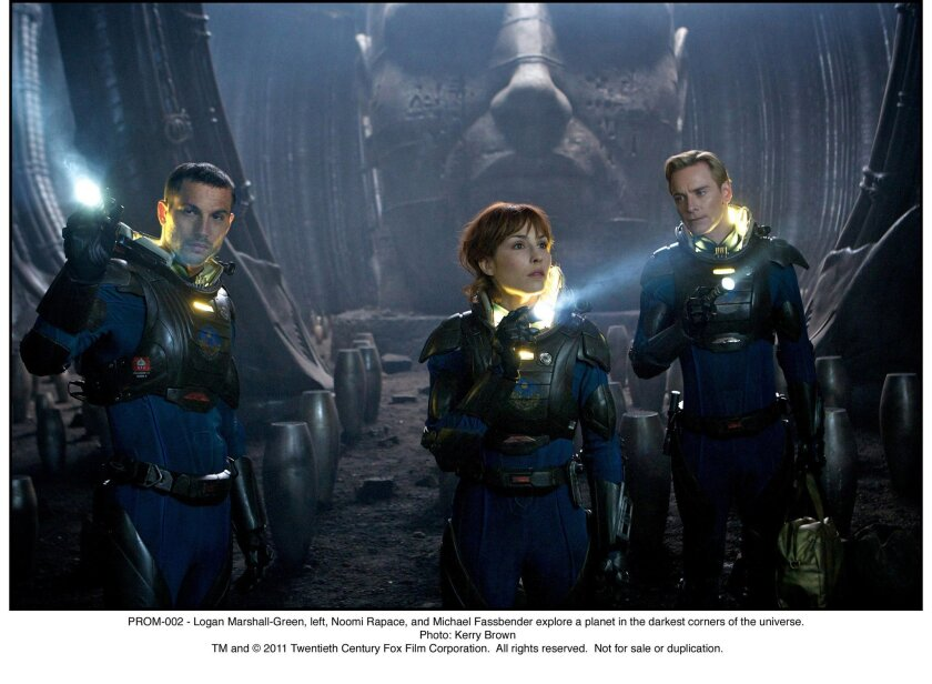 Logan Marshall-Green, left, Noomi Rapace, and Michael Fassbender explore a planet. Kerry Brown - TM and © 2011 Twentieth Century Fox Film Corporation.