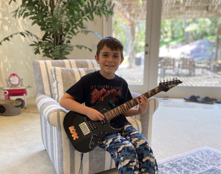"Sage Canyon third grader Austin played Green Day's ""Holiday"" on his electric guitar in the virtual talent show."