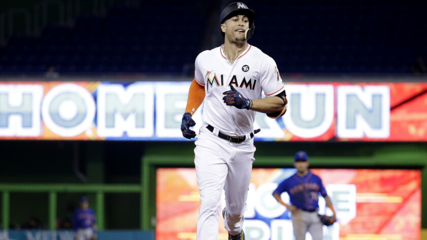 Giancarlo Stanton is closing in on the 61 home runs hit by Roger Maris in 1961, which the Miami Marlins slugger considers the single-season record and not the 73 hit by Barry Bonds in 2001.