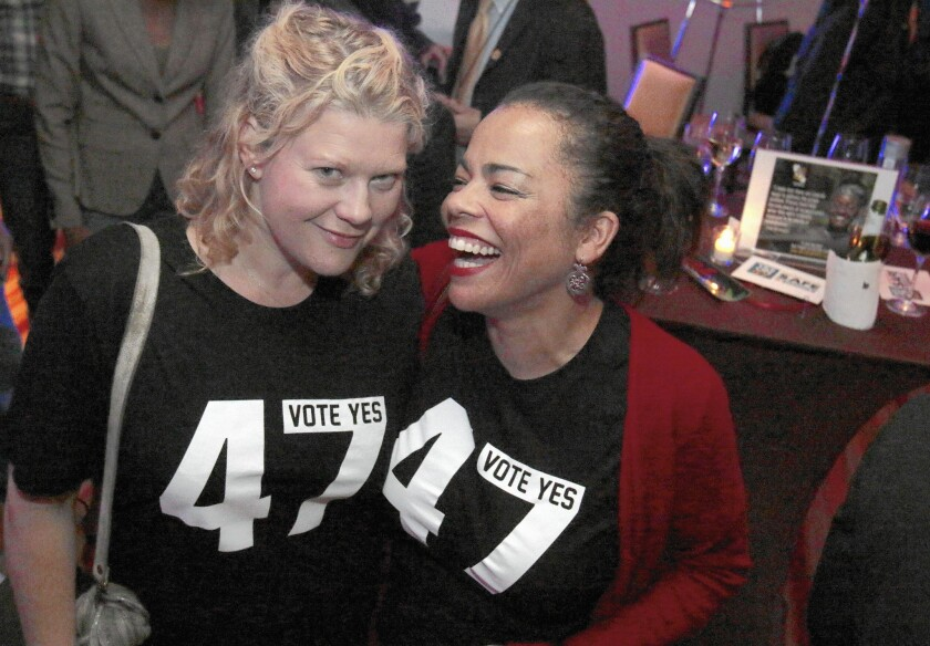 Donna Jo Thorndale, left, and Sabra Williams, both supporters of Proposition 47, celebrate as voters pass the measure.