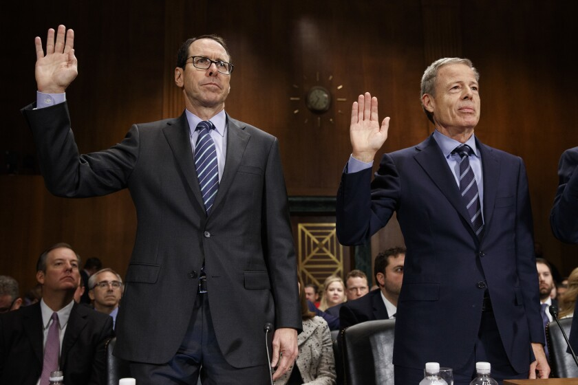 AT&T CEO Randall Stephenson, left, and Time Warner CEO Jeffrey Bewkes are sworn in on Capitol Hill prior to testifying before a Senate Judiciary subcommittee hearing on the proposed merger between AT&T and Time Warner.