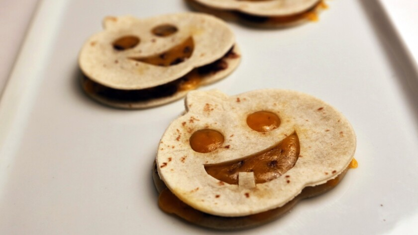 Pumpkin-faced quesadillas
