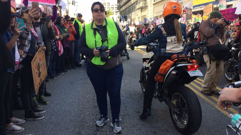 Photographer Catherine Opie waits for the women's march to kick off in downtown Los Angeles.