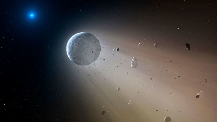 This artist's rendering provided by the Harvard-Smithsonian Center for Astrophysics shows an asteroid slowly disintegrating as it orbits a white dwarf star.