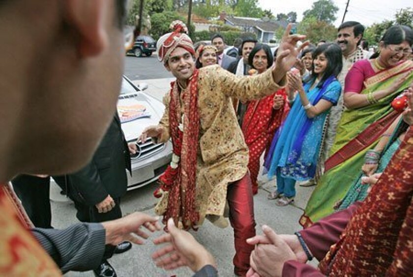 Groom Nikhil Warrier arrived in a convertible (a steep hill prohibited the traditional horse-drawn carriage). (Peggy Peattie / Union-Tribune)