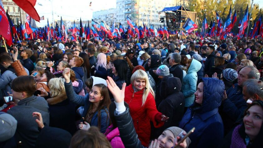 People wait on Nov. 9, 2018, for Denis Pushilin, acting leader of the self-proclaimed Donetsk Republic. Russian President Vladimir Putin on Wednesday signed a decree easing citizenship rules for people living in eastern Ukraine's separatist territories.