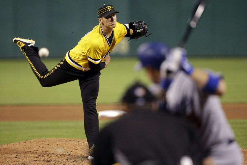 Pittsburgh Pirates starting pitcher Chad Kuhl delivers in the third inning of a baseball game against the Los Angeles Dodgers in Pittsburgh, Sunday, June 26, 2016. It is Kuhl's major league debut. (AP Photo/Gene J. Puskar)
