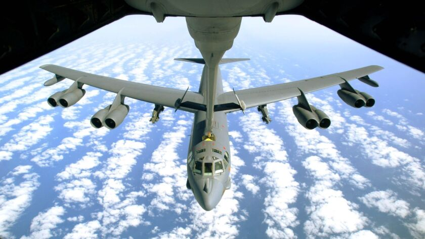 A U.S. Air Force B-52 bomber returning from a mission in Iraq with empty bomb racks under its wings