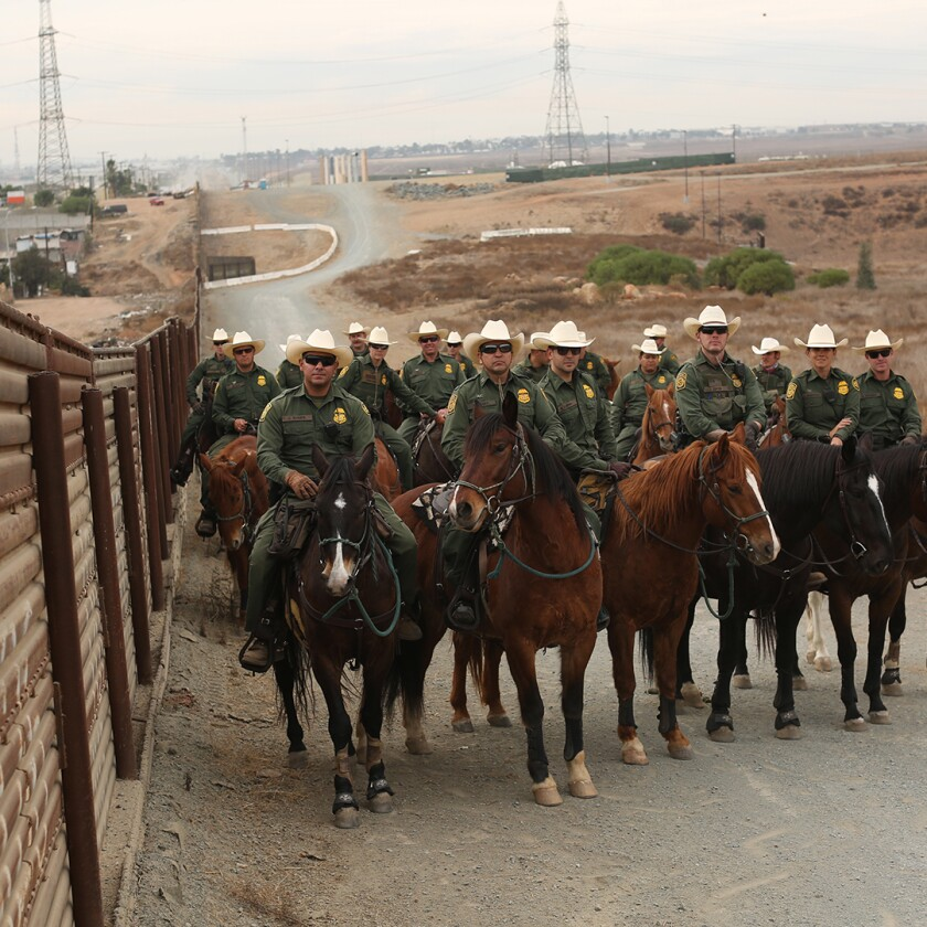 Border Patrol agents on horseback