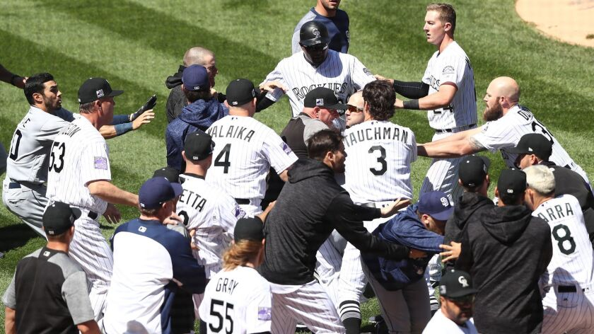 Benches clear as a brawl breaks out between the Rockies and the Padres on Wednesday.