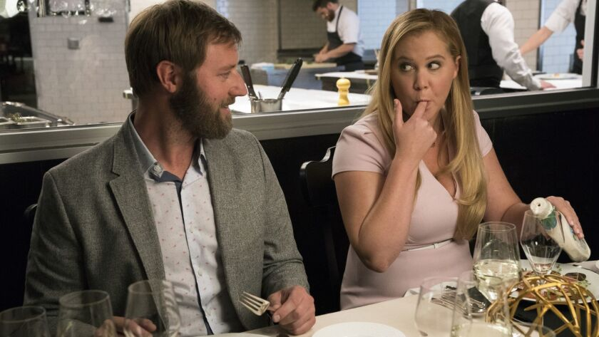 """Rory Scovel and Amy Schumer in the movie """"I Feel Pretty,"""" which was recently released by STX Entertainment."""