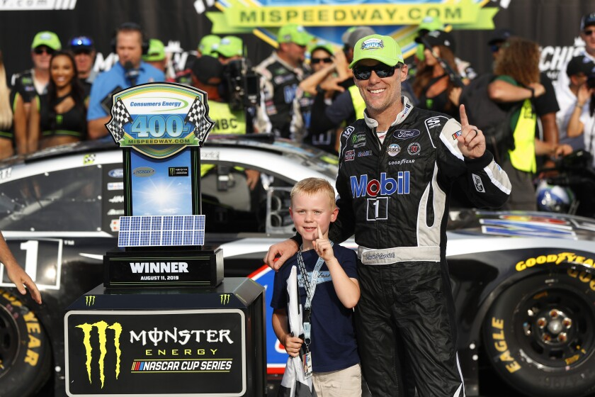 Kevin Harvick celebrates with his son, Keelan, after winning a NASCAR Cup Series race.