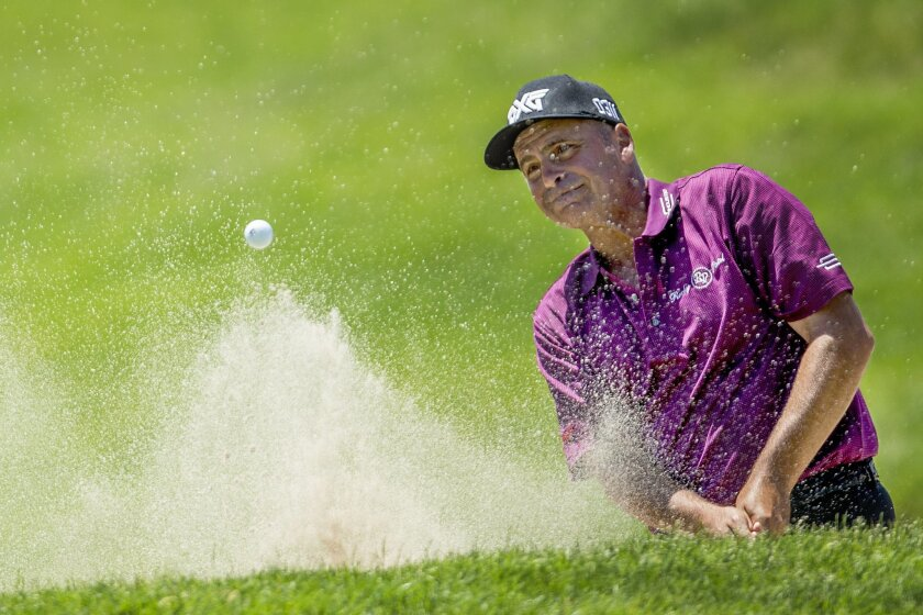 Rocco Mediate blast out of the sand on the fifth hole during the final round of the Senior PGA Championship golf tournament at Harbor Shores Golf Club in Benton Harbor, Mich., Sunday, May 29, 2016. (AP Photo/Robert Franklin)