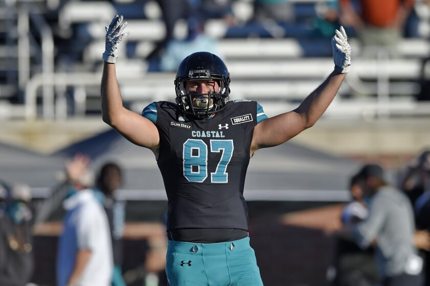 Coastal Carolina's Michael McFarlane reacts during the second half of an NCAA college football game against Appalachian State, Saturday, Nov. 21, 2020, in Conway, S.C. Coastal Carolina won 34-23. (AP Photo/Richard Shiro)