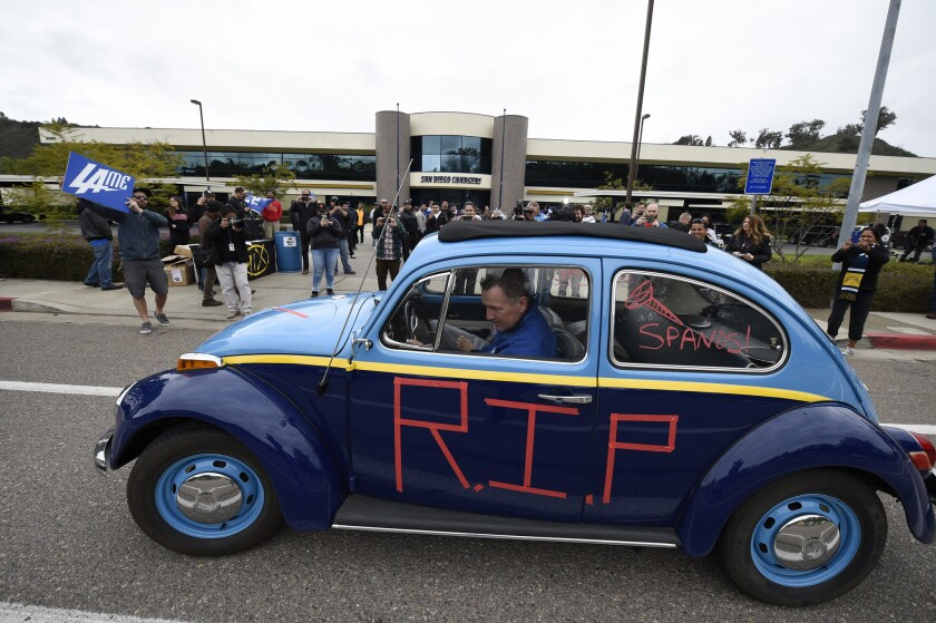 """Tom Sutton pulls his Volkswagen """"Bolt Bug"""" out of the San Diego Chargers headquarters driveway after the team announced that it will move to Los Angeles Thursday Jan. 12, 2017, in San Diego. (AP Photo/Denis Poroy)"""