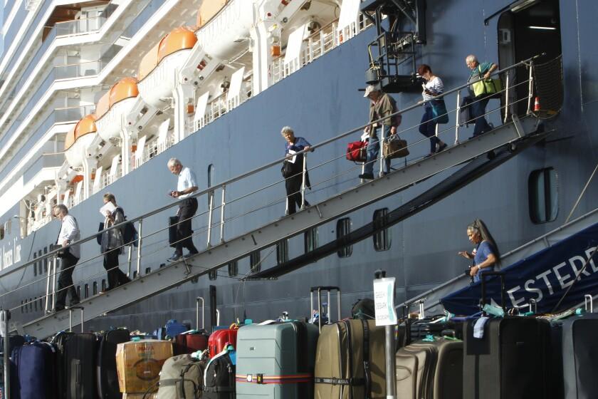 Westerdam cruise ship passengers disembark at the port of Sihanoukville, Cambodia, on Saturday.