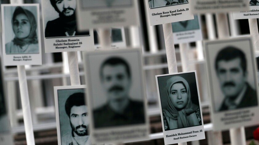 Photos of people who have been executed in Iran are displayed during a rally outside United Nations headquarters in New York on Sept. 20, 2016. Iran carries out more executions per capita than any country in the world, most for drug-related crimes.