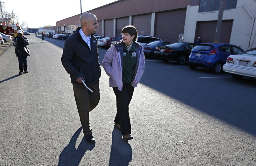 Neel Kashkari, left, who is exploring a possible run for governor in 2014, talks with Sister Libby Fernandez, executive director of Loaves and Fishes, while touring the homeless shelter in Sacramento, Calif., Wednesday, Dec. 4, 2013. Kashkari, a former U.S. Treasury staffer who headed up the federal bank bailout program, says he is a Republican with a social libertarian bent. Kashkari said the states economic policies should be focused on helping the poor. (AP Photo/Rich Pedroncelli)