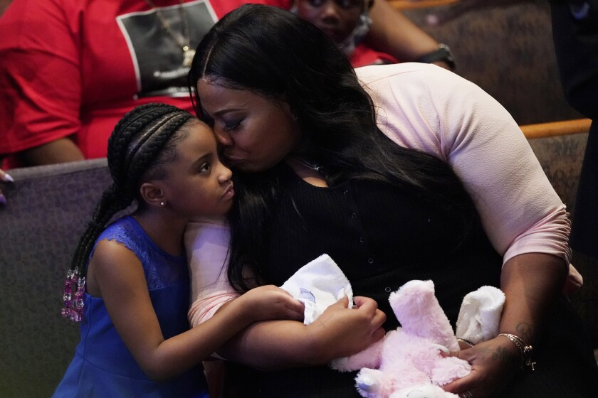 Roxie Washington comforts Gianna Floyd, the daughter of George Floyd at his funeral service in Houston.