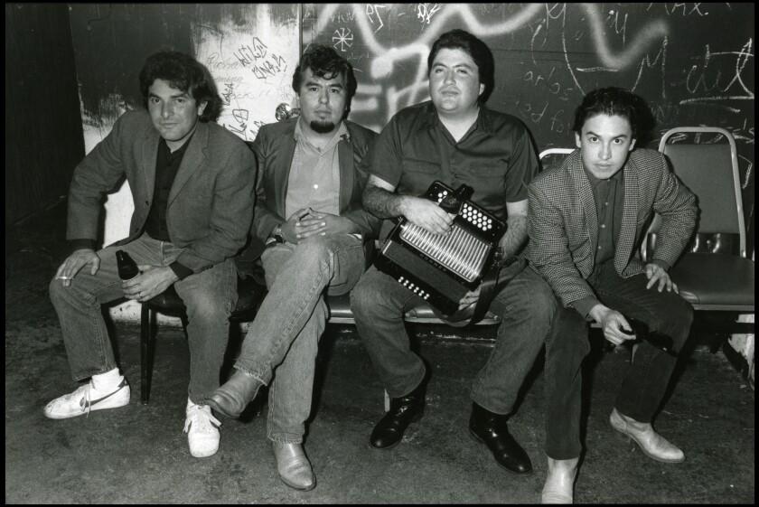 A black-and-white photo of Los Lobos members Conrad Lozano, left, Cesar Rosas, David Hidalgo and Louis Pérez in 1982.