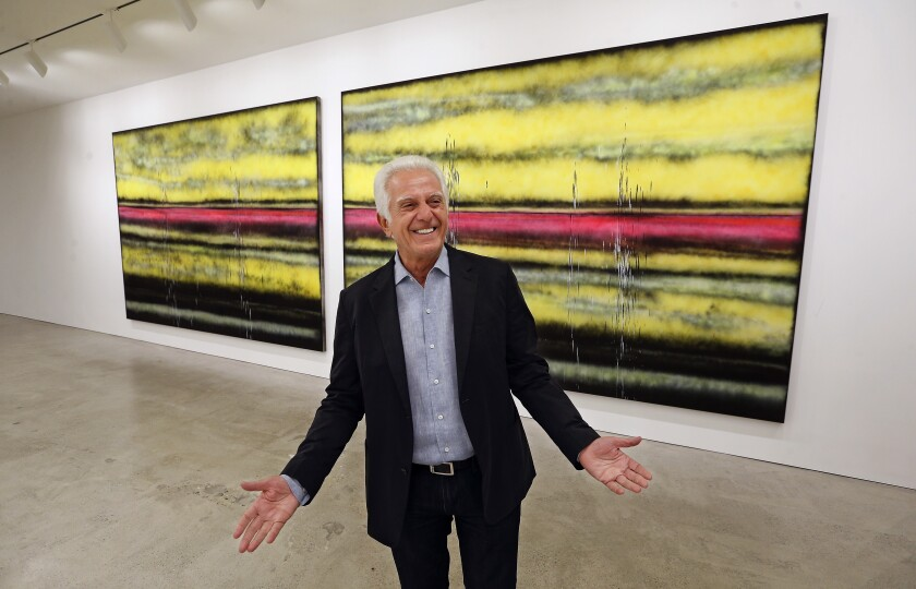 "Maurice Marciano, photographed in front of Sterling Ruby's ""SP308"" during the 2017 installation of the Marciano Art Foundation, which he founded with his brother Paul Marciano."