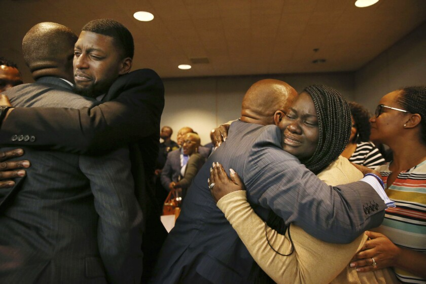 Odell Edwards and Charmaine Edwards, parents of Jordan Edwards, react to a guilty of murder verdict during a trial of former cop Roy Oliver, who was charged with the murder of 15-year-old Jordan Edwards, at the Frank Crowley Courts Building in Dallas on Tuesday, Aug. 28, 2018.