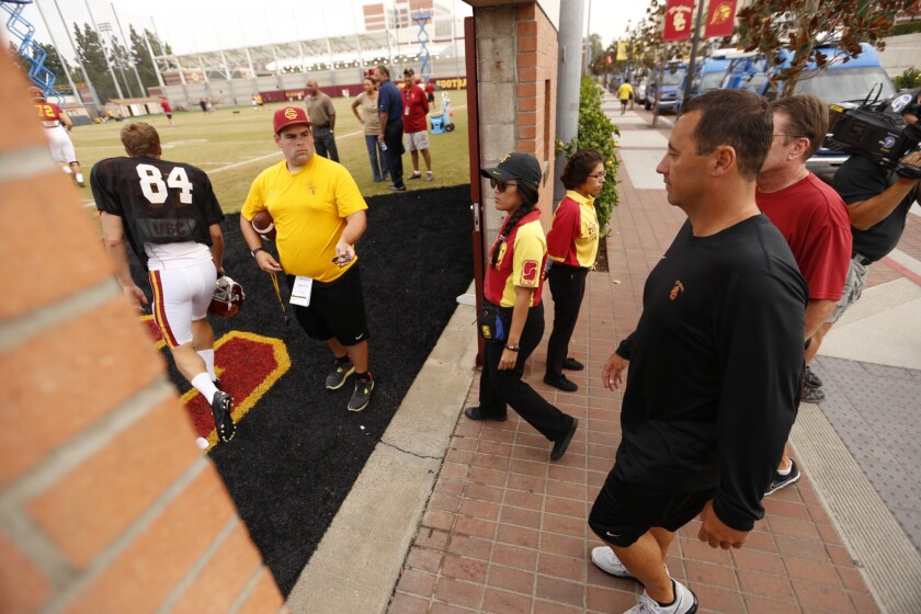 """USC Coach Steve Sarkisian takes to the Trojans' practice field Tuesday morning after addressing the media about his behavior and language at Saturday's """"Salute to Troy"""" event."""