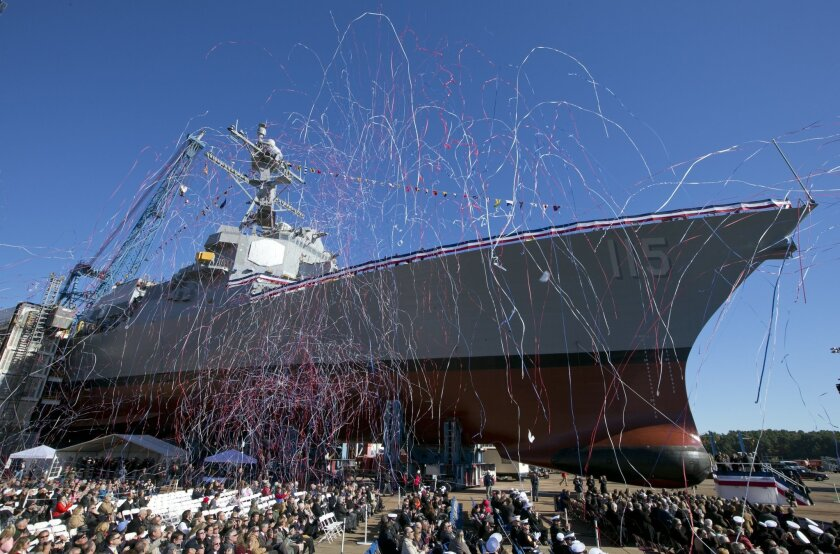 Streamers fly during the christening the Rafael Peralta, the 35th Arleigh Burke Class Missile Destroyer to be built by Bath Iron Works, Saturday, Oct. 31, 2015, in Bath, Maine. The warship is named for Sgt. Rafael Peralta, who was killed in action on Nov. 15, 2004 while clearing houses in the city
