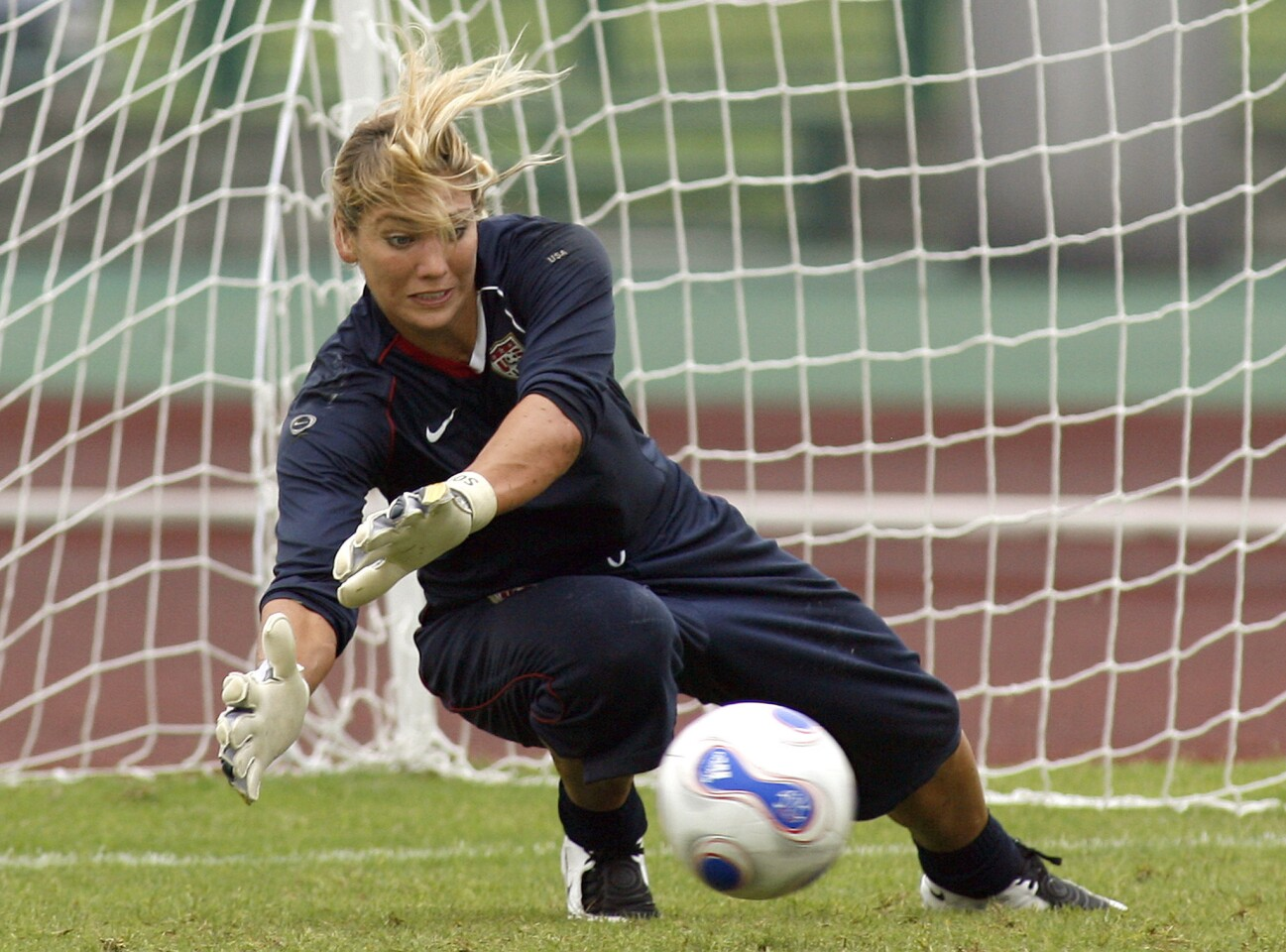 US women football team's goalkeeper Hope Solo blocks the ball during a training session in Chengdu, China's southwestern province of Sichuan, 08 September 2007. The United States will face North Korea on September 11 in group B matches of 2007 FIFA women's football world cup in Chengdu. AFP PHOTO/ LIU Jin (Photo credit should read LIU JIN/AFP/Getty Images) ORG XMIT: