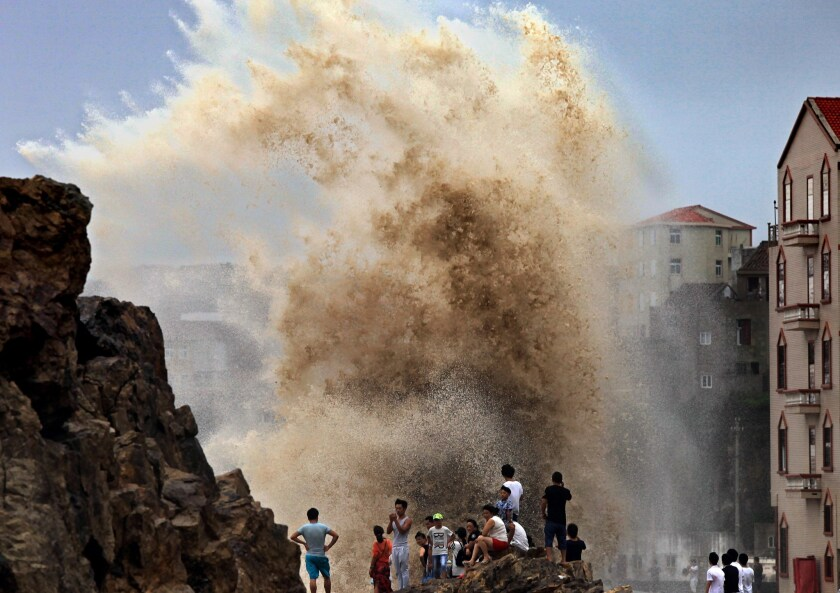 Residents gather to see huge waves stirred up by incoming Typhoon Soudelor in Wenling, China, on Aug. 8.