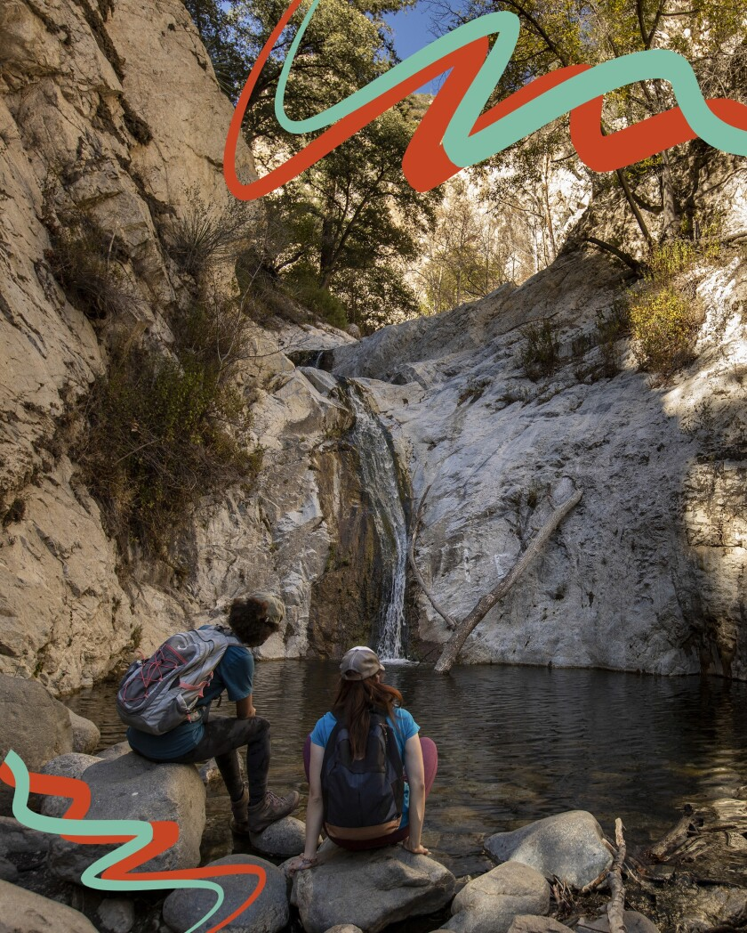 Hikers enjoy the view at lower Switzer Falls in Angeles National Forest.
