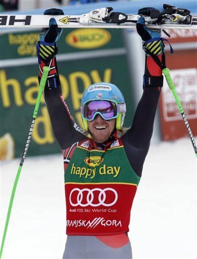 Ted Ligety, of the United States, celebrates after winning an alpine ski, men's World Cup giant slalom, in Kranjska Gora, Slovenia, Saturday, March 9, 2013. (AP Photo/Alessandro Trovati)