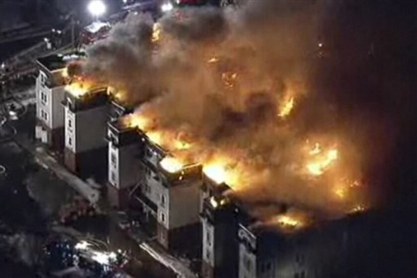In this frame grab from video released by NBC New York, a fire blazes at a condominium complex under construction Tuesday, Jan. 4, 2011, in Rahway, N.J. The fire started around 1:30 a.m. at the three-story building along Route 27. (AP Photo/NBC New York) MANDATORY CREDIT; NO SALES