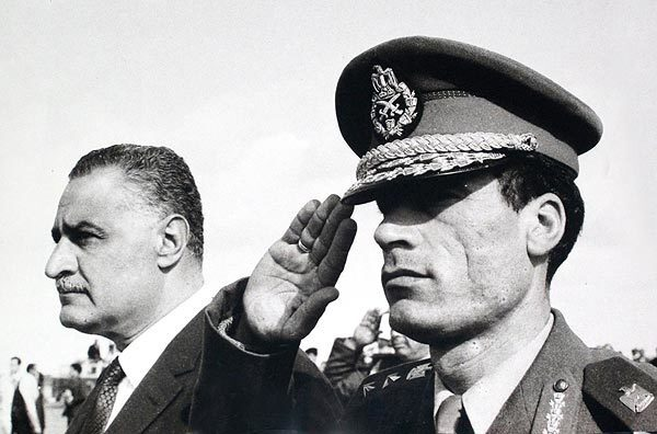 In this undated 1969 photo, Col. Moammar Kadafi salutes as he appears with Egypt's Prime Minister Gamal Abdel Nasser in Suez, Egypt.