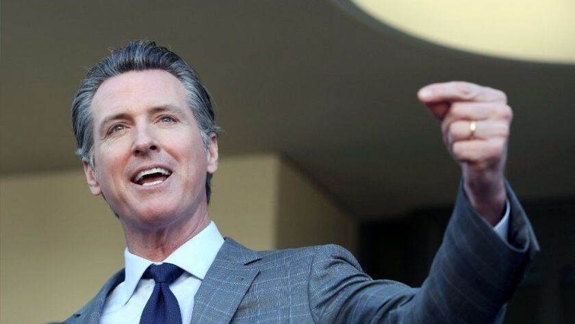 Gov. Newsom, shown in Long Beach on Feb. 19, has fast-tracked legislation requiring new transparency standards for charter schools.