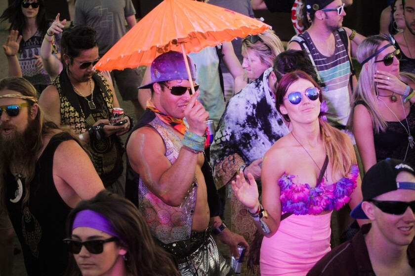 Party-goers dance as the sun set over day two of the second week of the Coachella Valley Music and Arts Festiva.