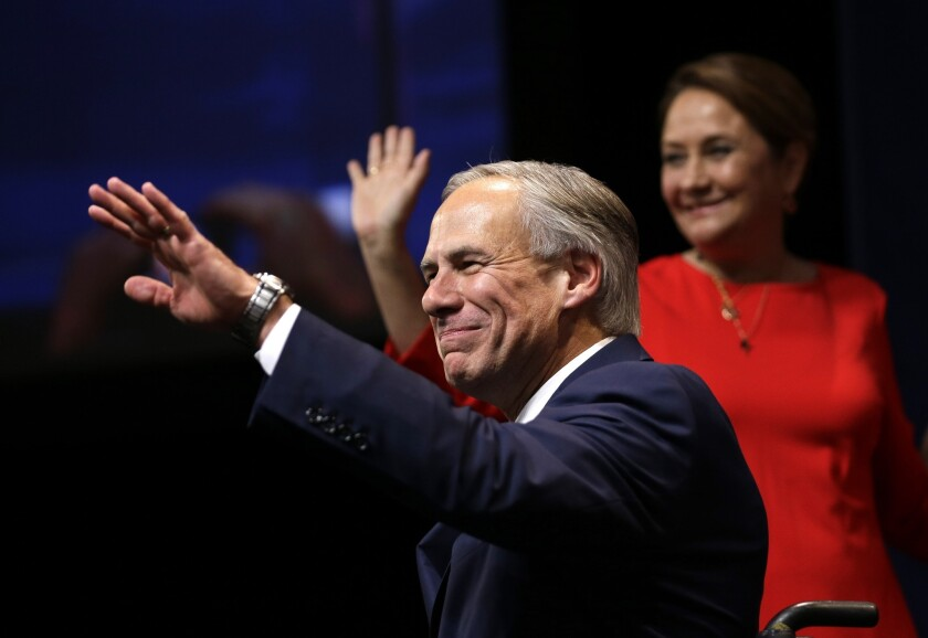 Republican Greg Abbott acknowledges supporters in Austin after winning the race for Texas governor.