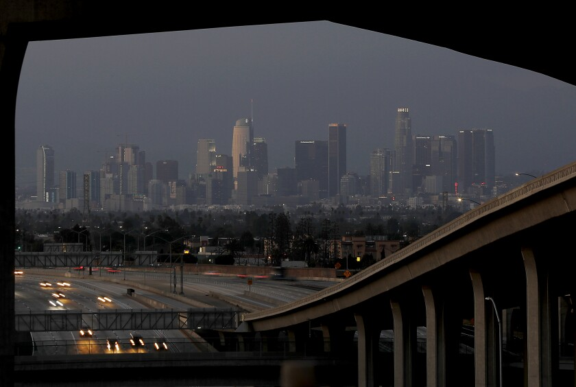 Light traffic moves through the Harbor and Century freeway interchange in Los Angeles on April 2, 2020, during the coronavirus lockdown.