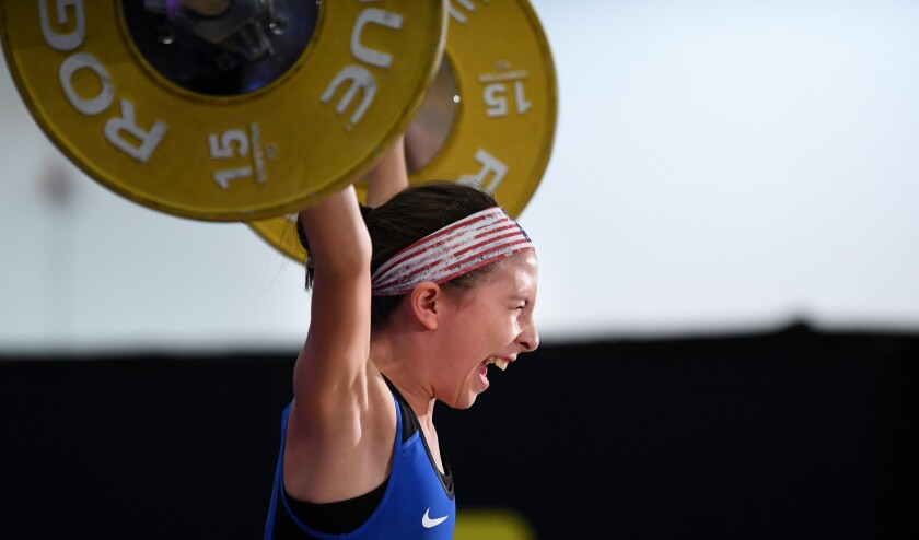 Addison Griffith makes a lift in the under-13 category at the USA Weightlifting National Youth Championships at the Anaheim Convention Center.