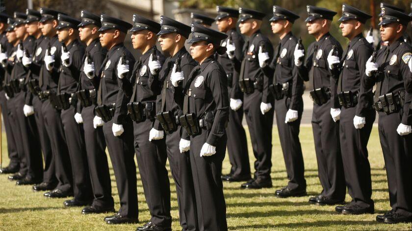 LOS ANGELES, CA – APRIL 13, 2018: New Los Angeles Police Officer Teresa Altamirano, center, durin